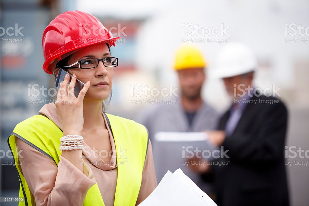 Woman manager talking on the phone at commercial dock stock photo