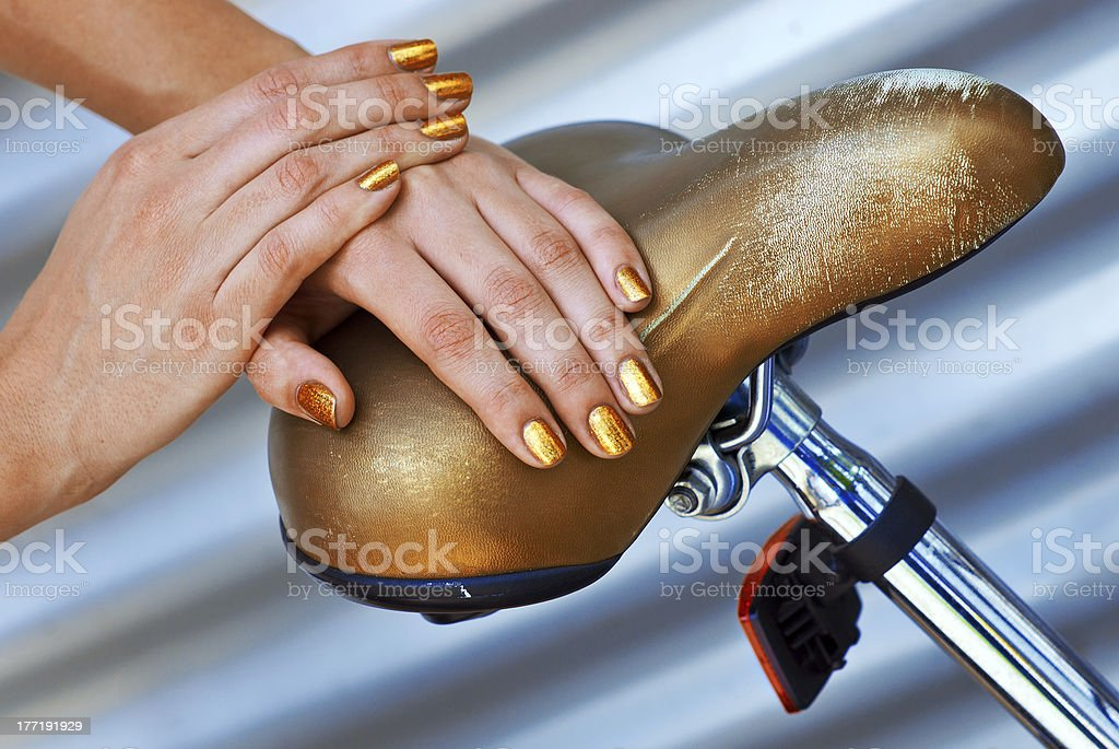 woman manicured golden nails royalty-free stock photo