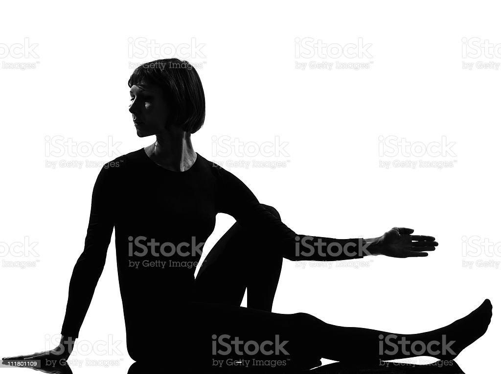 woman Marichyasana yoga sage pose stock photo