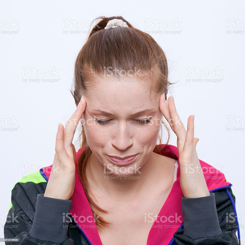 A woman massaging her temples to calm down royalty-free stock photo
