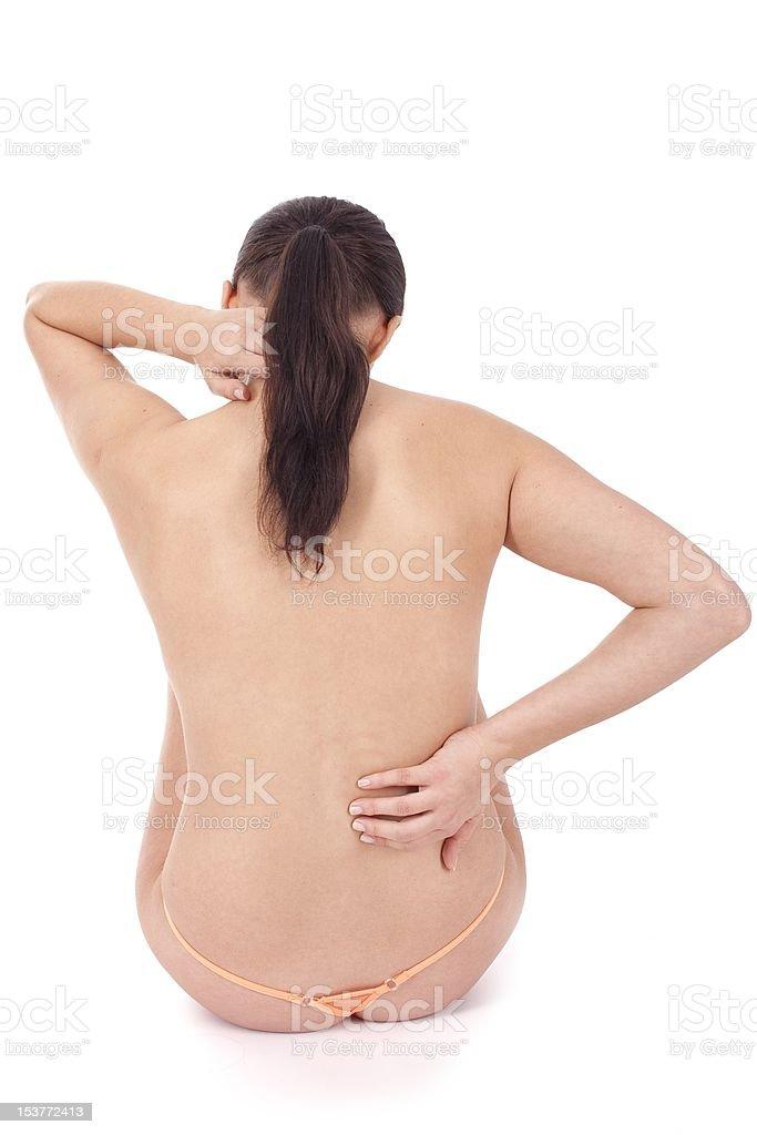 Femme masser des douleurs du dos et de la nuque photo libre de droits