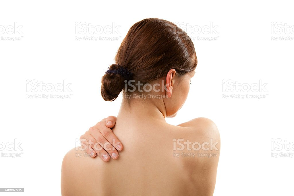 Woman massaging pain back isolated on white royalty-free stock photo