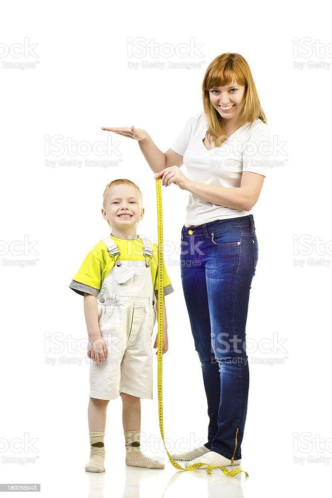 woman measuring child royalty-free stock photo