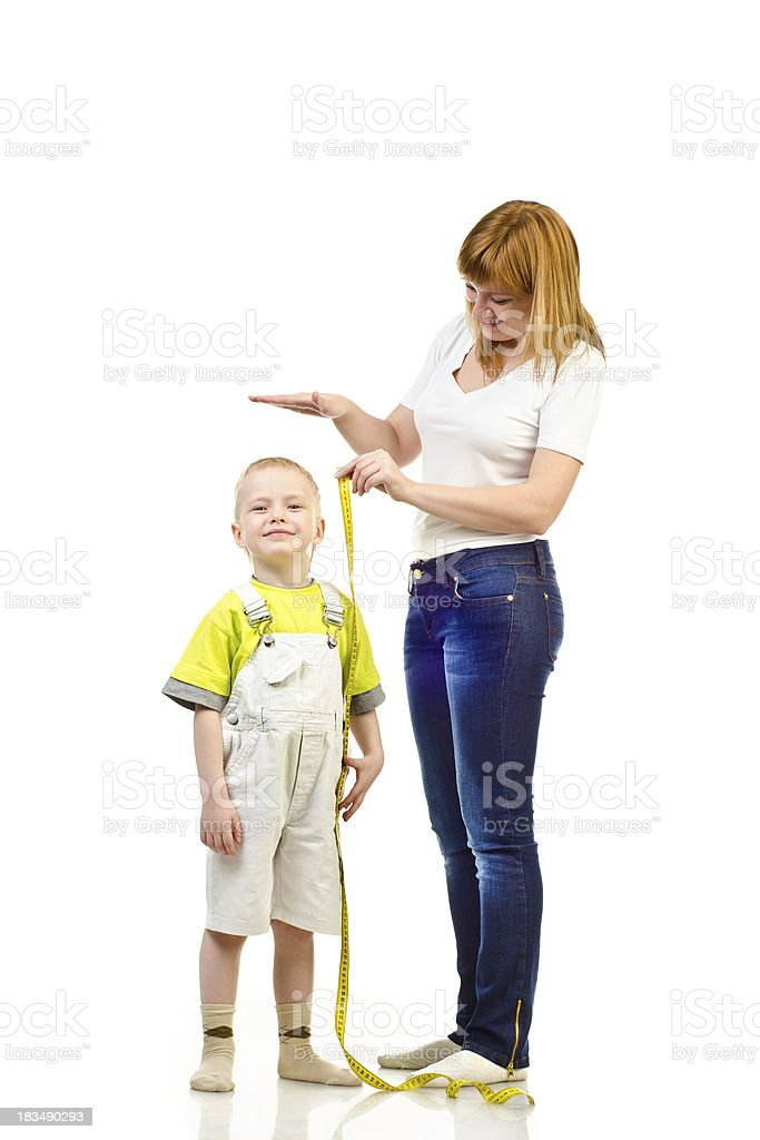 woman measuring child royalty-free stock photo