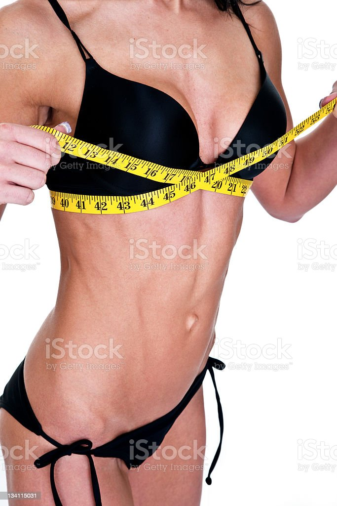 Woman measuring her breasts royalty-free stock photo