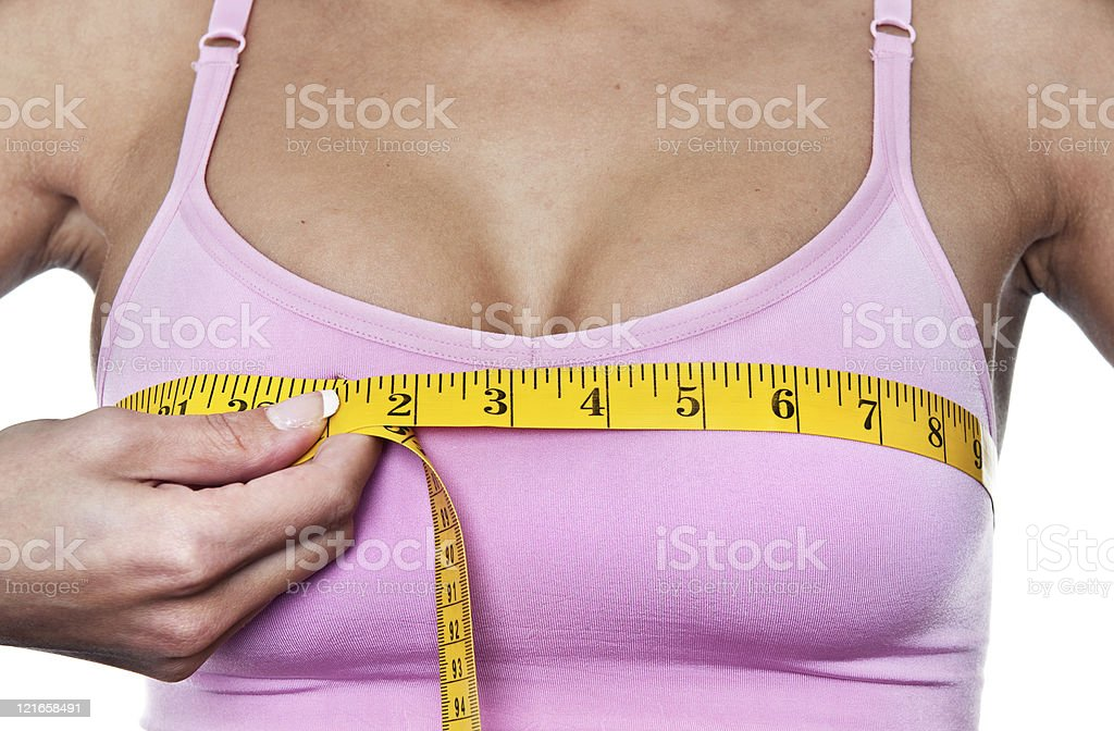 Woman measuring her bust line stock photo