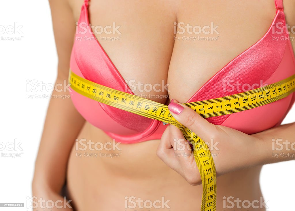 Woman measuring her bust stock photo