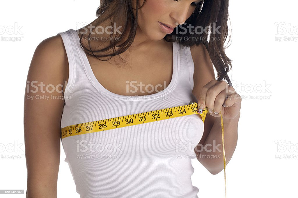 Woman measuring her chest stock photo