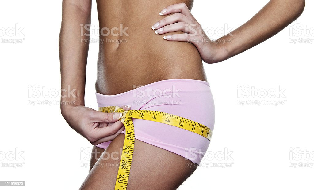 Woman measuring her hips royalty-free stock photo