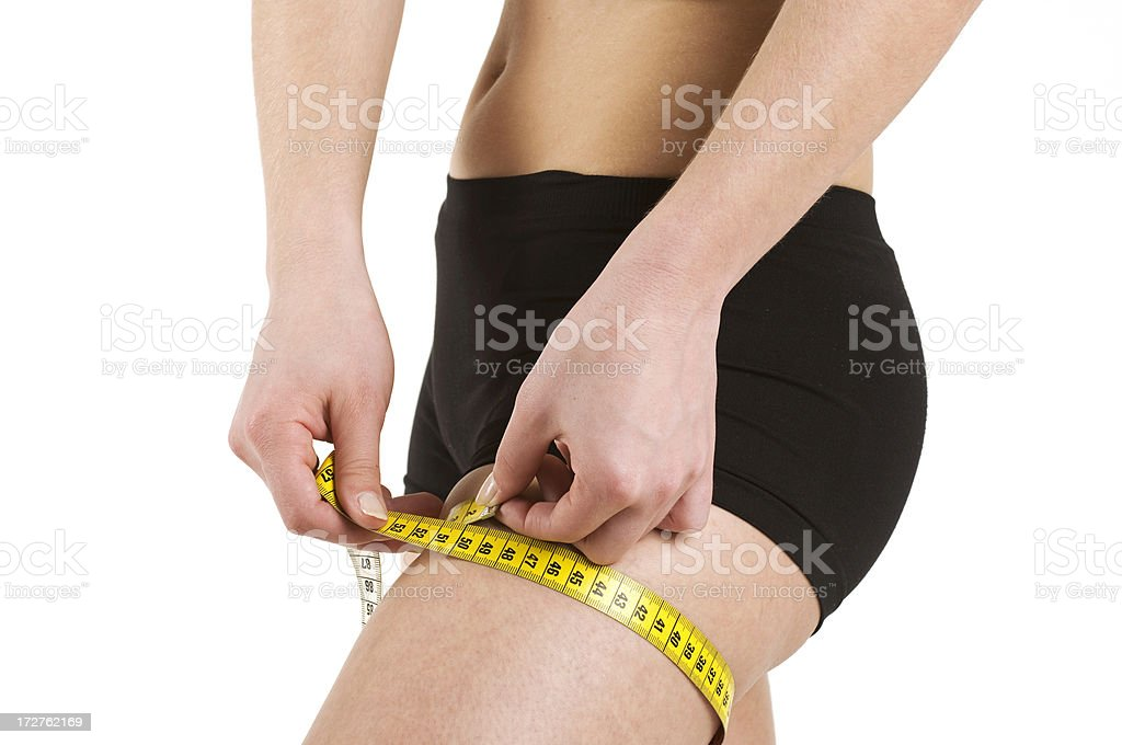 Woman measuring her leg royalty-free stock photo