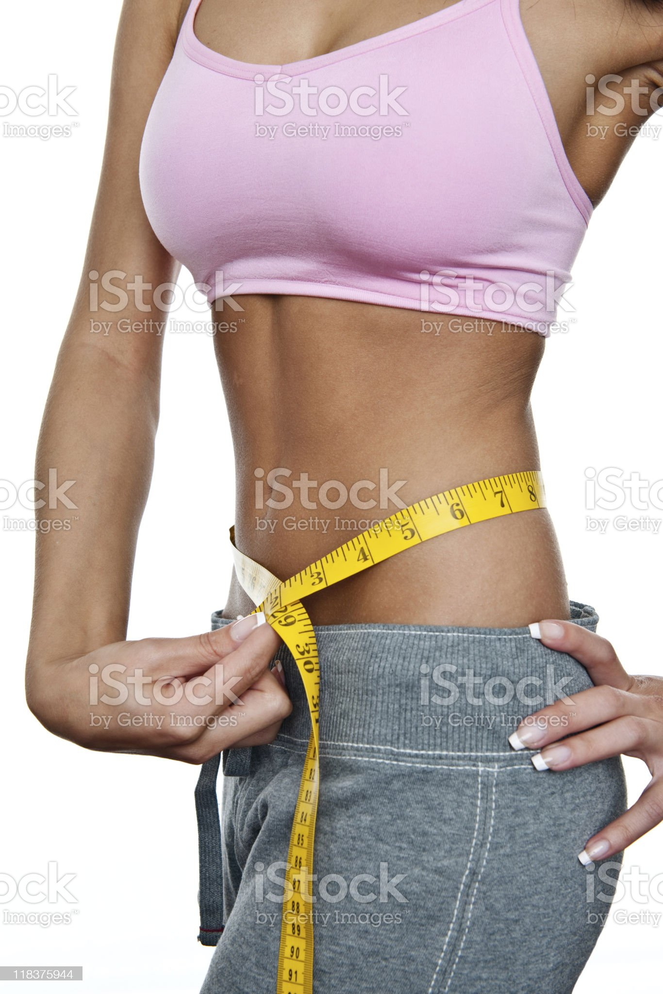 Woman measuring her perfect waist royalty-free stock photo