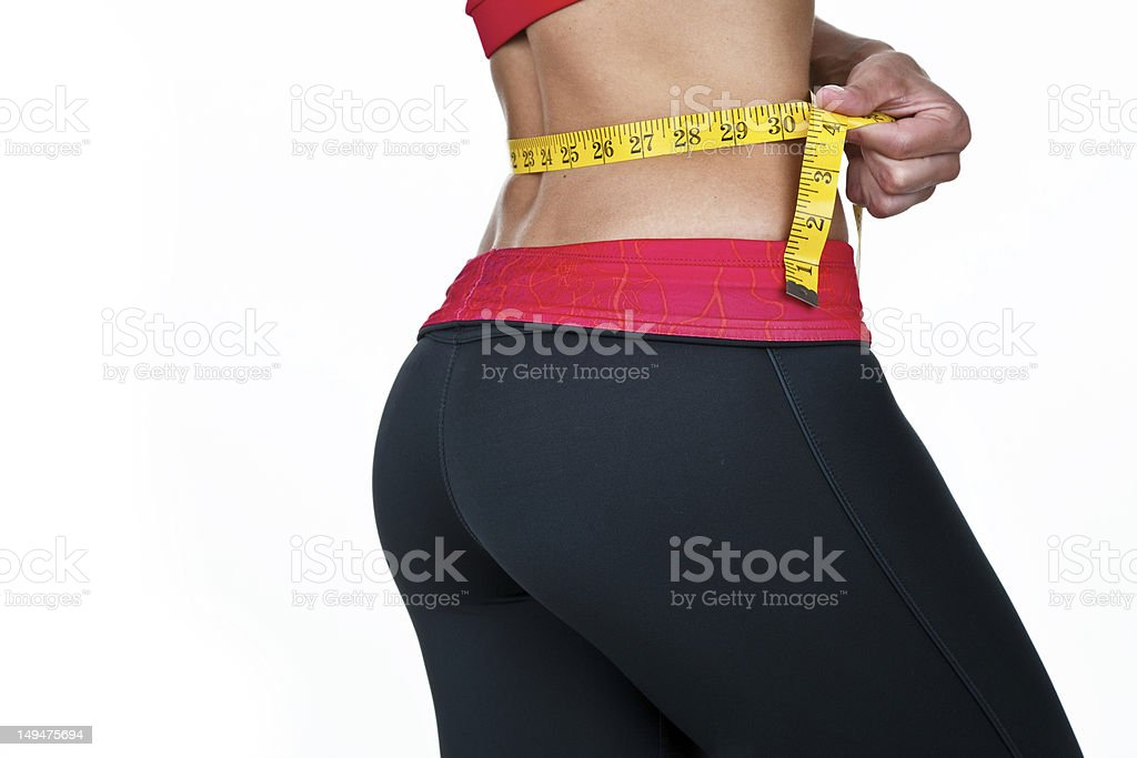 Woman measuring her waist royalty-free stock photo