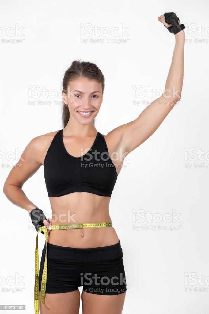 Woman measuring her waist stock photo