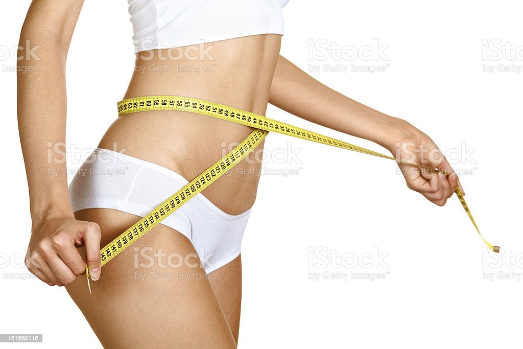 Woman measuring her waistline. Perfect Slim Body. Diet royalty-free stock photo