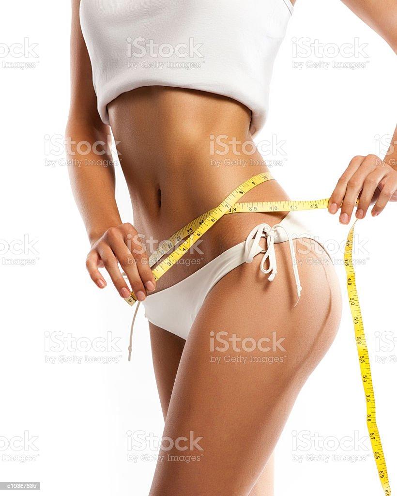 Woman measuring her waistline . Perfect Slim Body stock photo