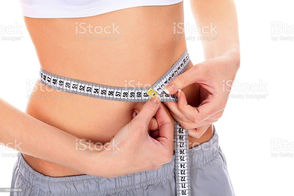 woman measuring her waistline royalty-free stock photo