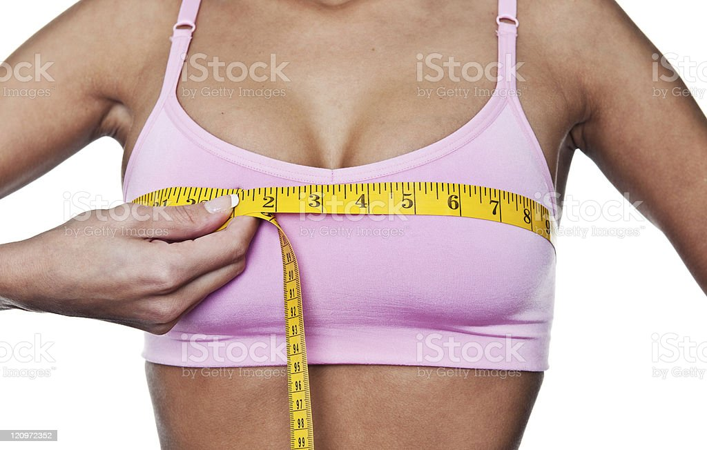 Woman measuring herself stock photo