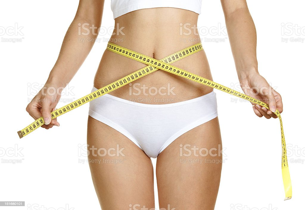 woman measuring perfect shape of beautiful thigh healthy lifestyles concept royalty-free stock photo