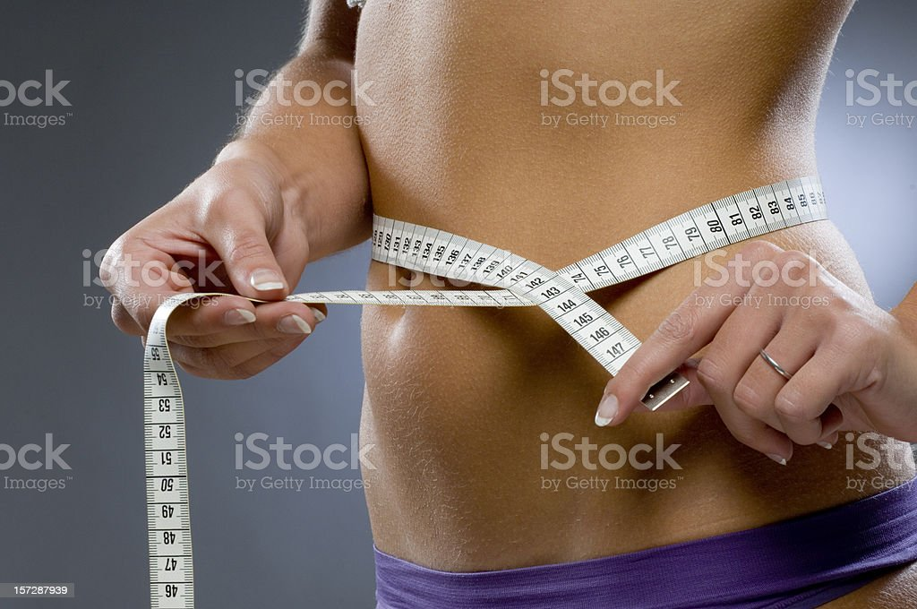 woman measuring the hips royalty-free stock photo