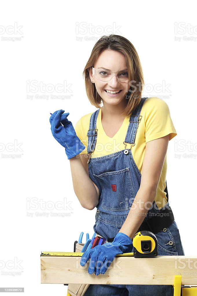 Woman Measuring Two by Four with Tape Measure on White royalty-free stock photo