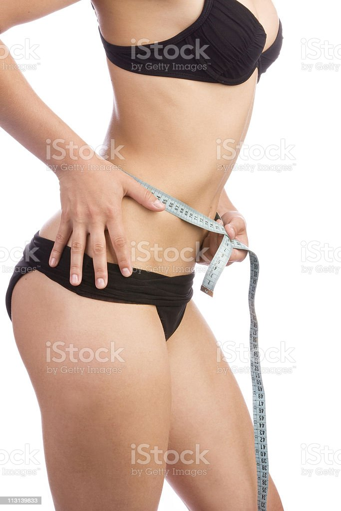 Woman measuring waist royalty-free stock photo
