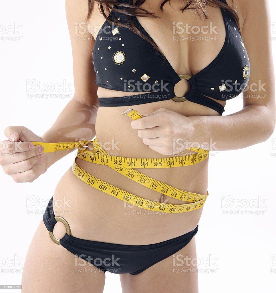 Woman measuring waist stock photo