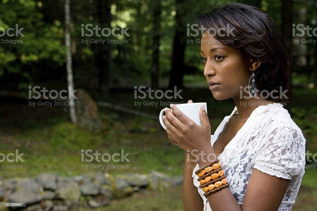 Woman Meditates With Cup Of Coffee royalty-free stock photo