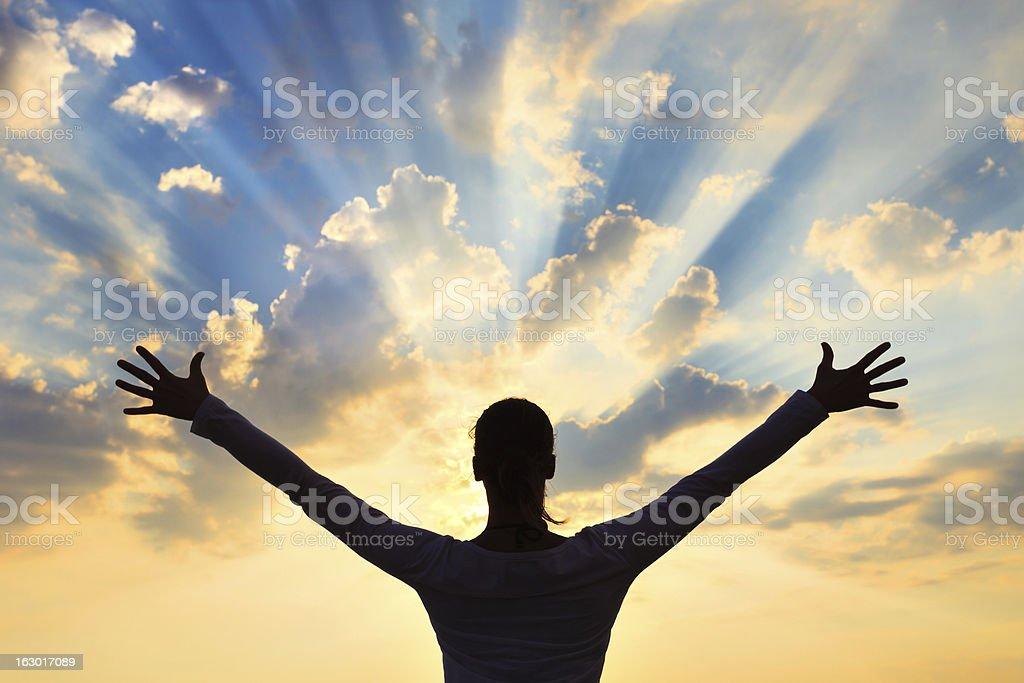 Woman Meditating At Sunset stock photo