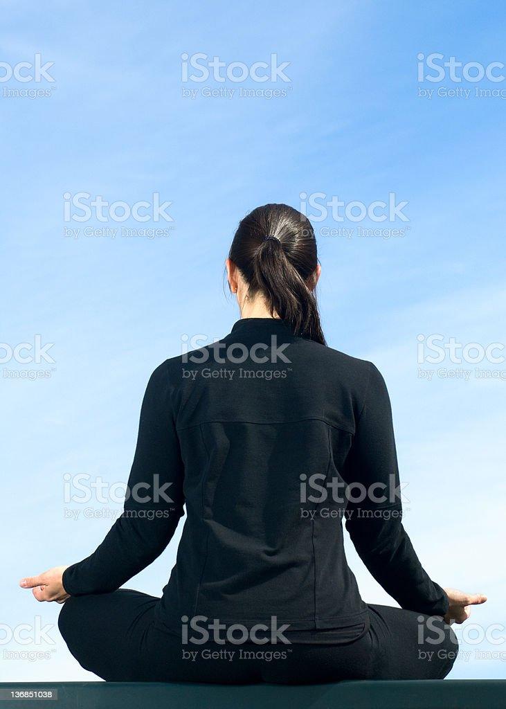Woman Meditating Atop a Wall royalty-free stock photo