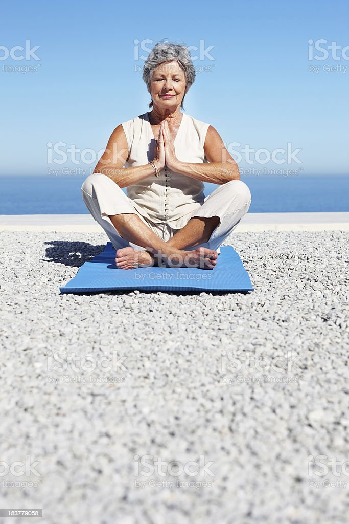 Woman meditating in lotus position royalty-free stock photo