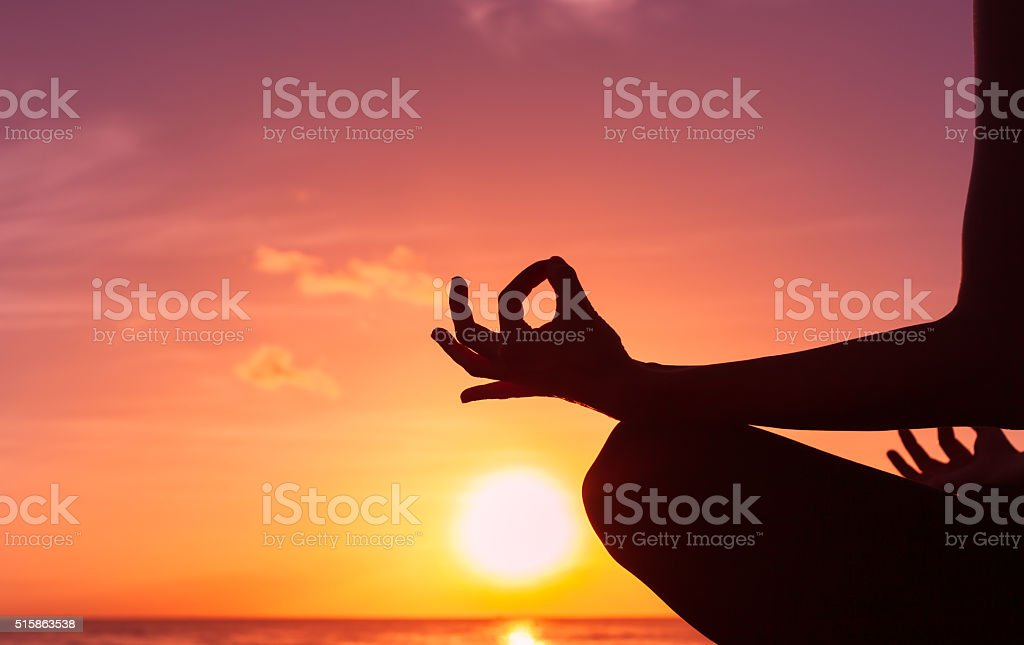 Woman meditating in lotus position stock photo