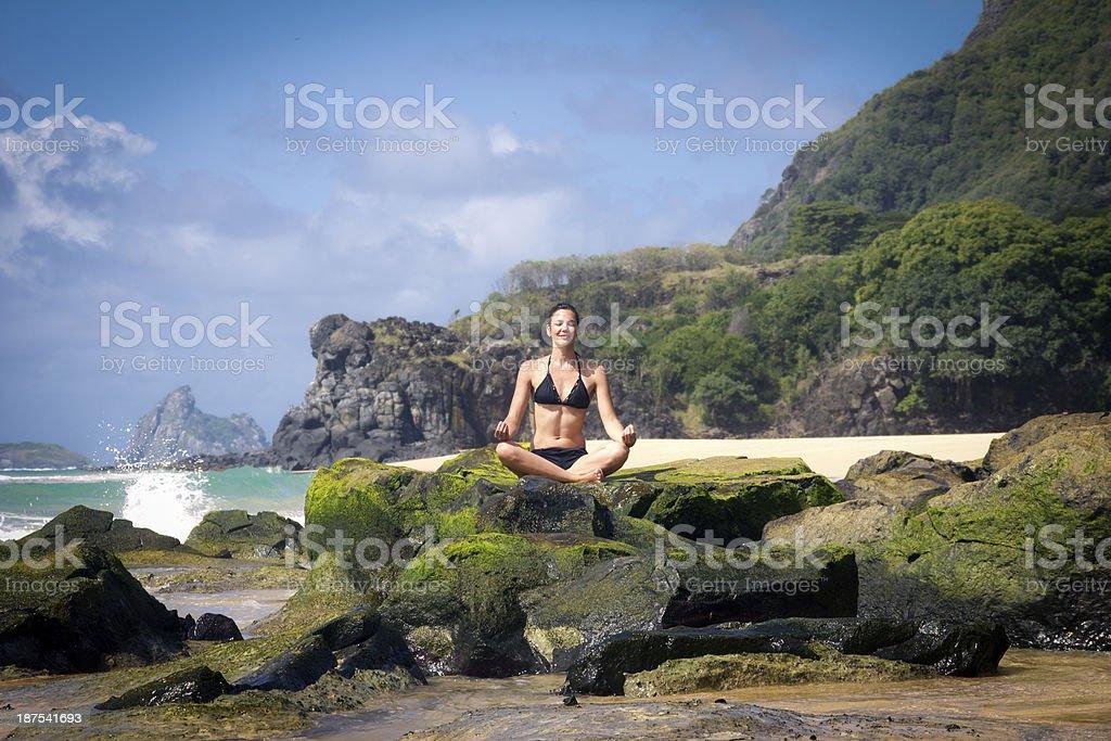 Woman meditating on beautiful beach royalty-free stock photo