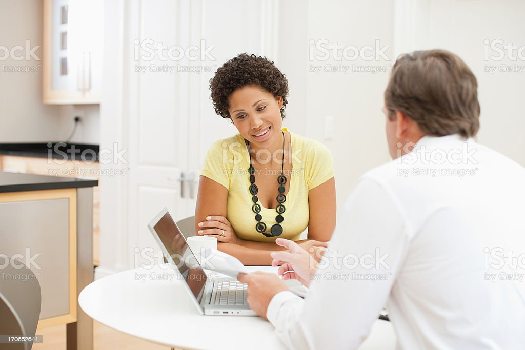 Woman meeting with financial advisor royalty-free stock photo