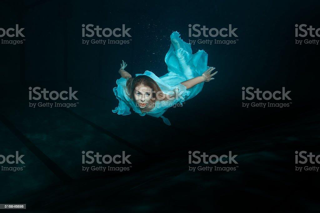 Woman mermaid under water. stock photo