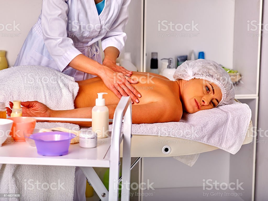 Woman middle-aged in spa salon with beautician. stock photo
