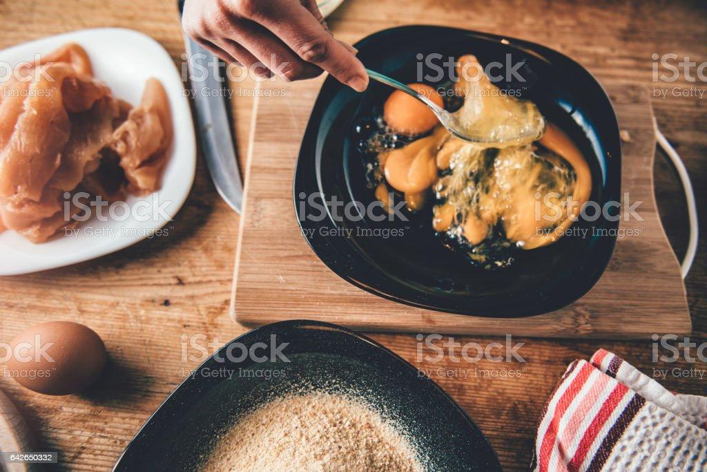 Woman mixing eggs stock photo