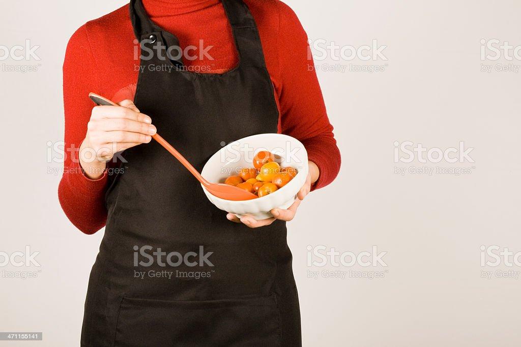 Woman mixing tomatoes stock photo