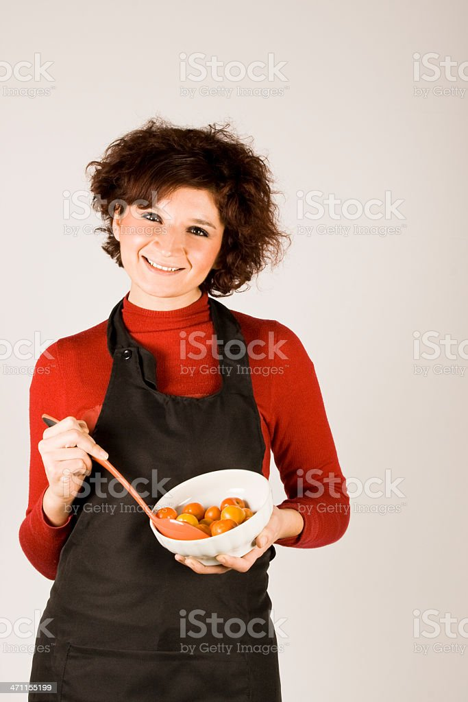 Woman mixing tomatoes royalty-free stock photo