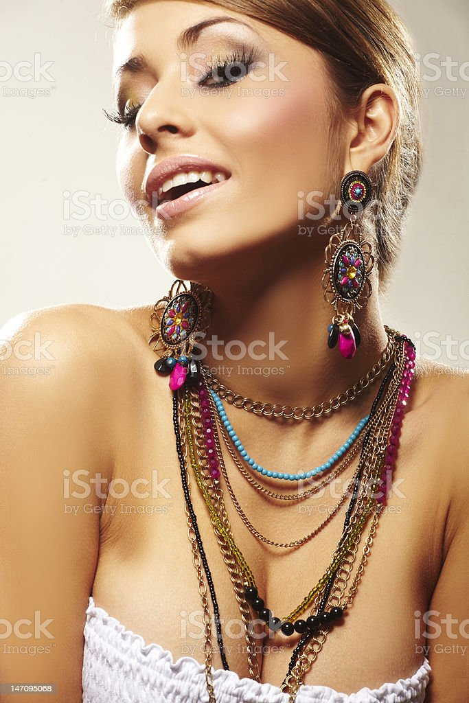 Woman modeling multicolor fashion earrings and necklaces royalty-free stock photo