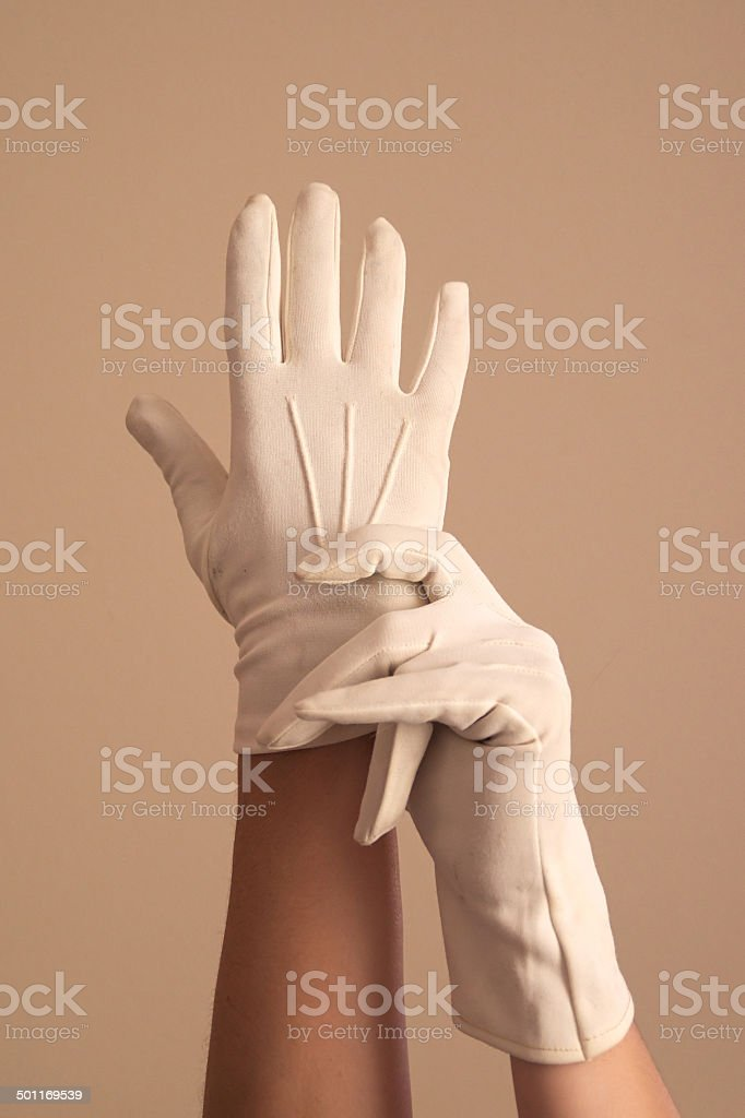woman modeling vintage formal white knit gloves stock photo