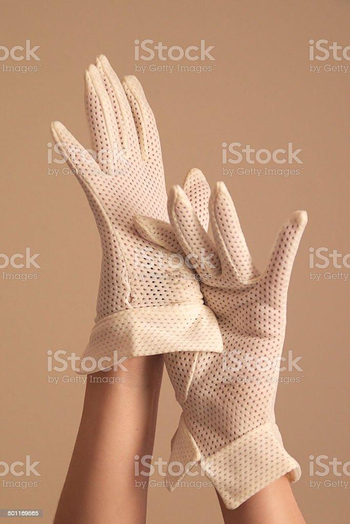 woman modeling vintage formal white mesh gloves stock photo