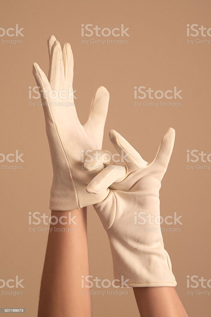 woman modeling vintage knit white gloves stock photo