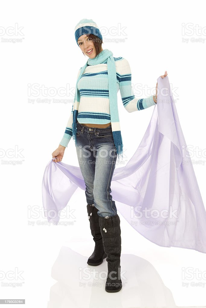 Woman Modeling Winter Clothing with Purple Drape royalty-free stock photo