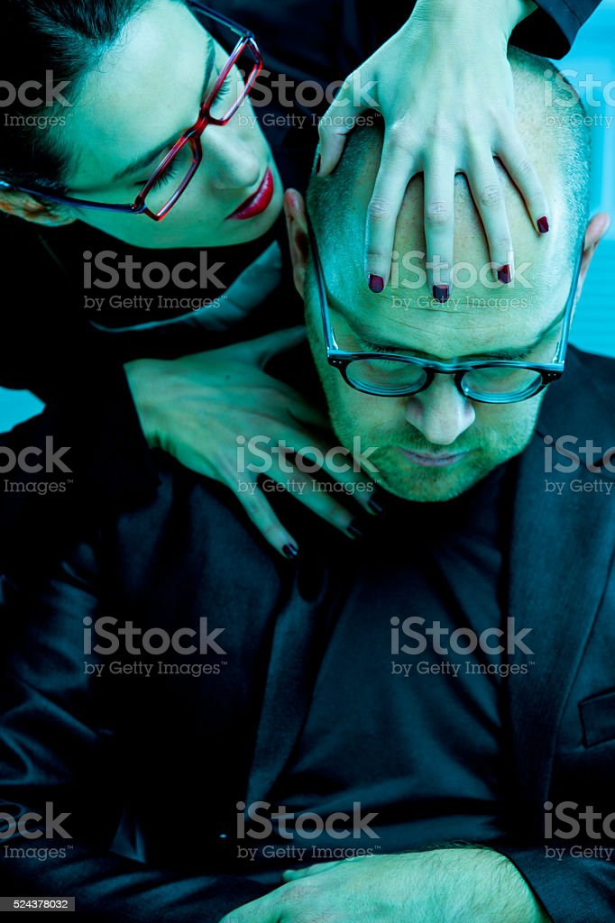 woman molests man on the job stock photo