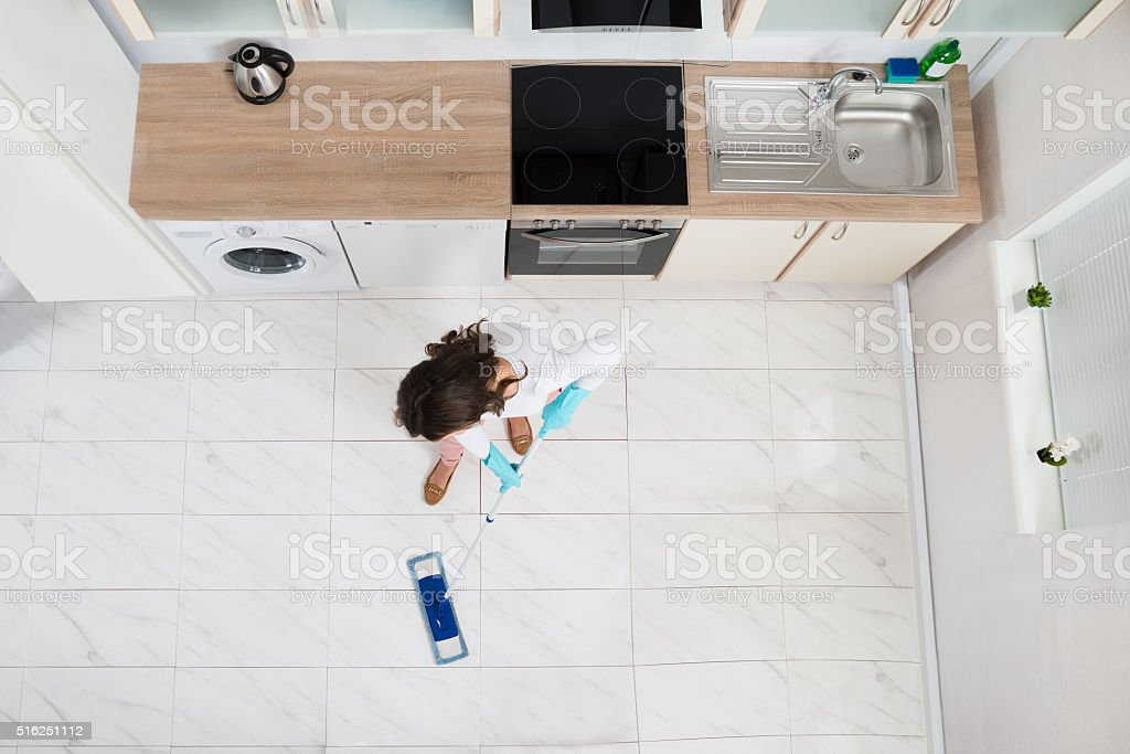 Woman Mopping Floor stock photo