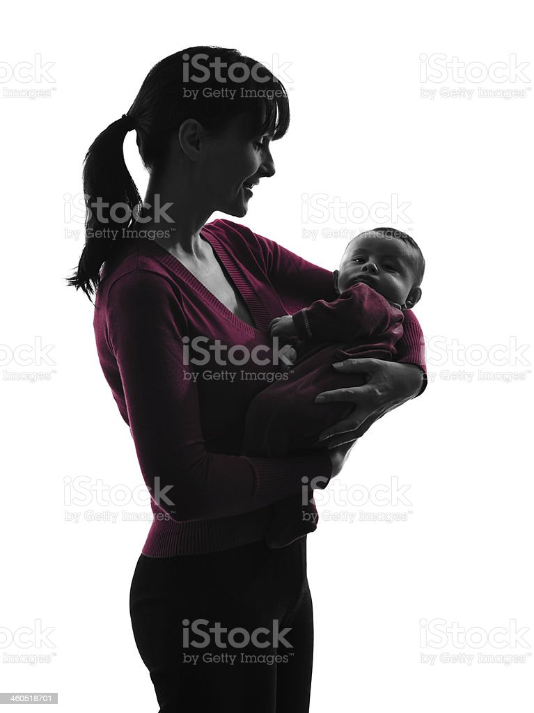 woman mother hugging baby silhouette stock photo