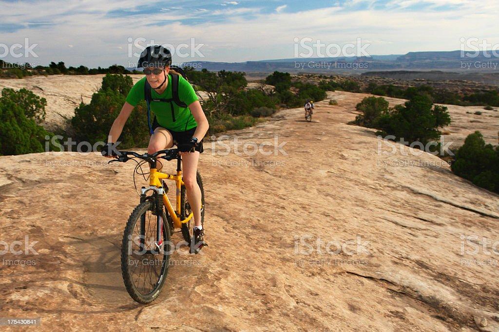 woman mountain bike desert sandstone landscape stock photo
