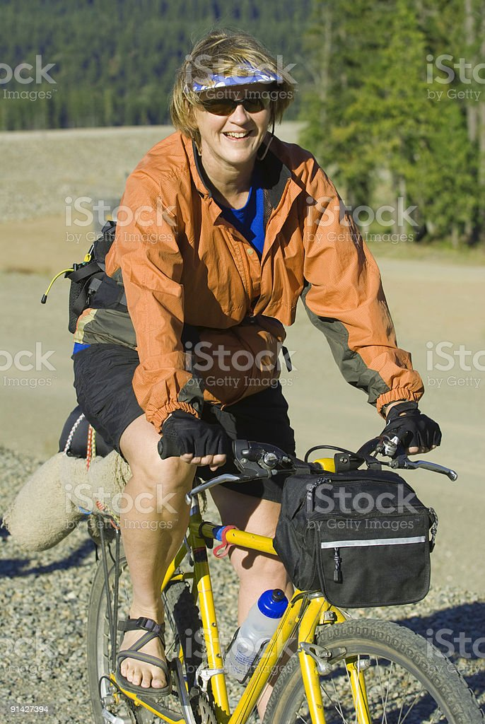 Woman Mountain Biking royalty-free stock photo