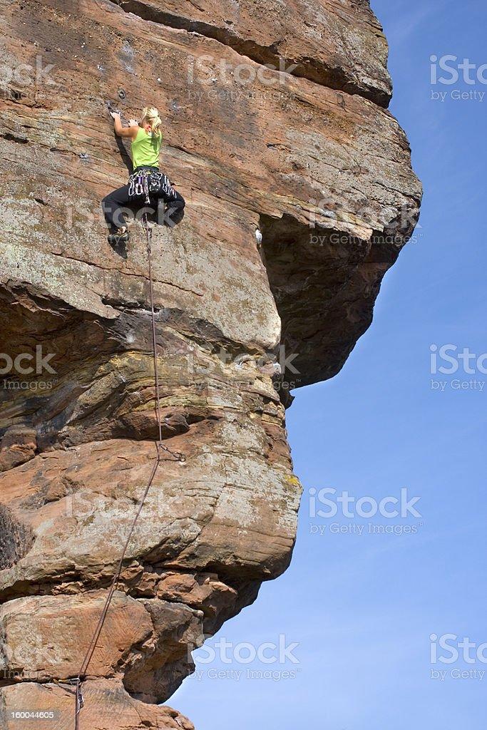 Woman mountain climbing royalty-free stock photo
