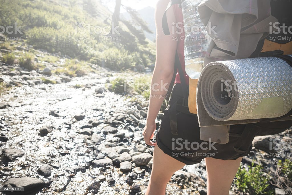 Woman mountain hiker at GR20 trail stock photo